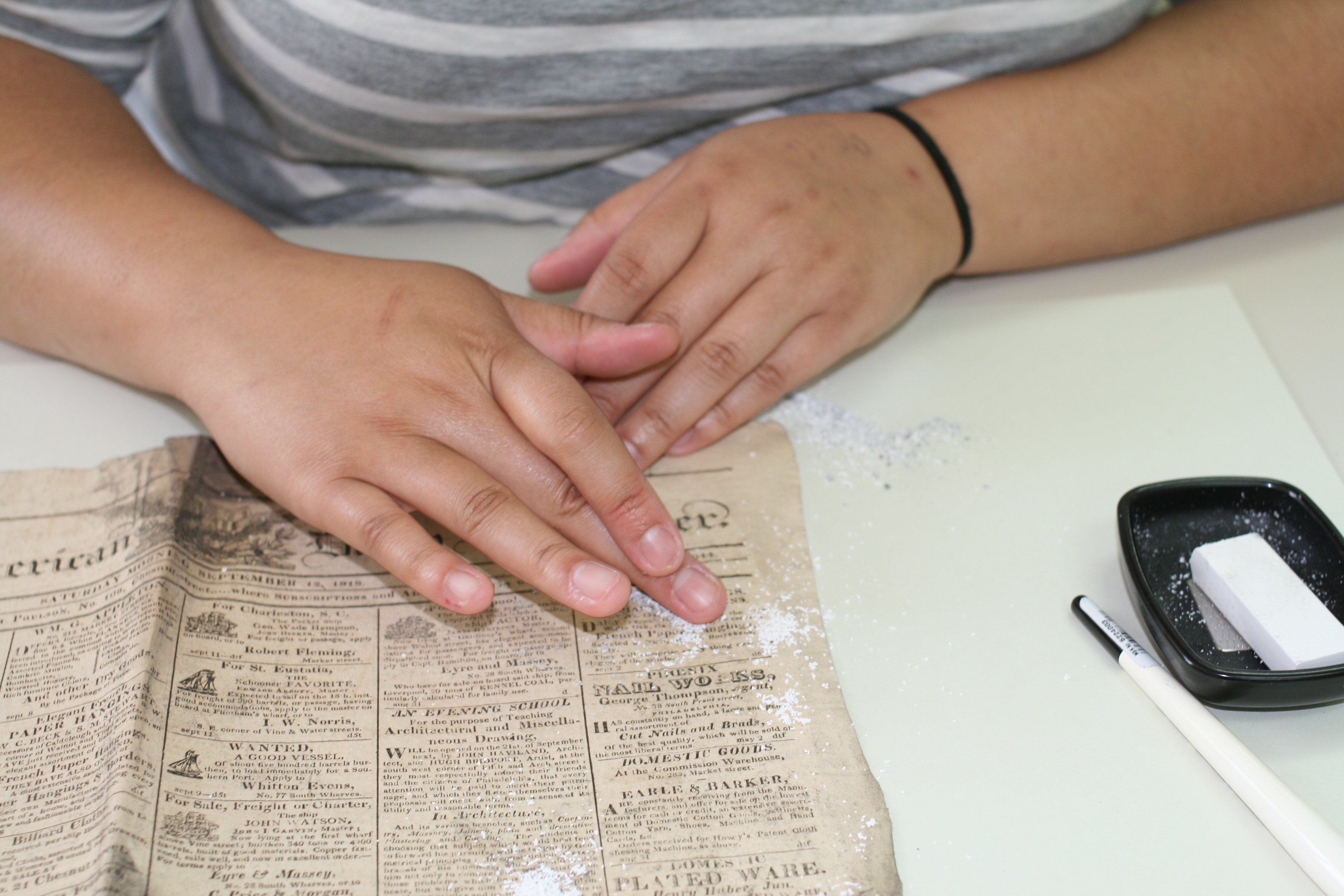 using eraser crumbs to clean newspaper