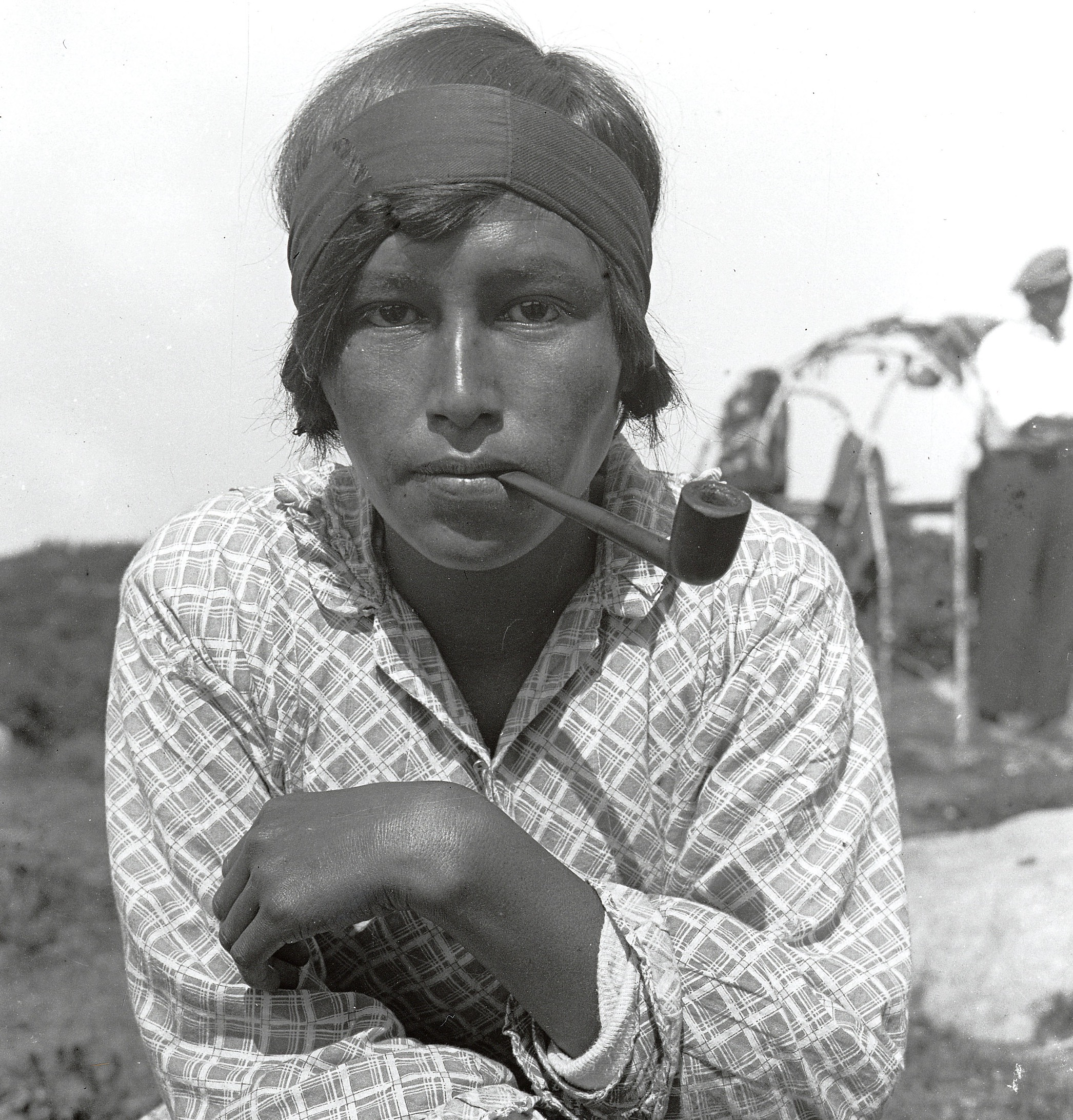 Native American woman with pipe