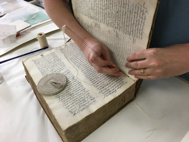 Woman Sewing Book Binding