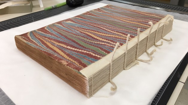 book with sewn spine exposed