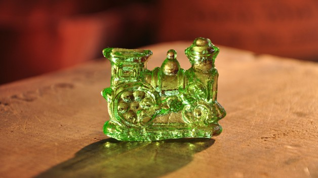 green train made of clear toy on a table