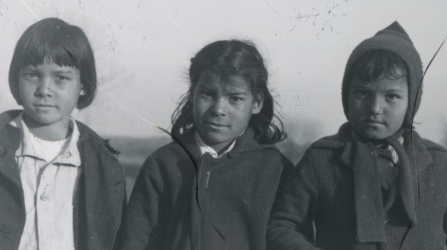 three children in black and white photo