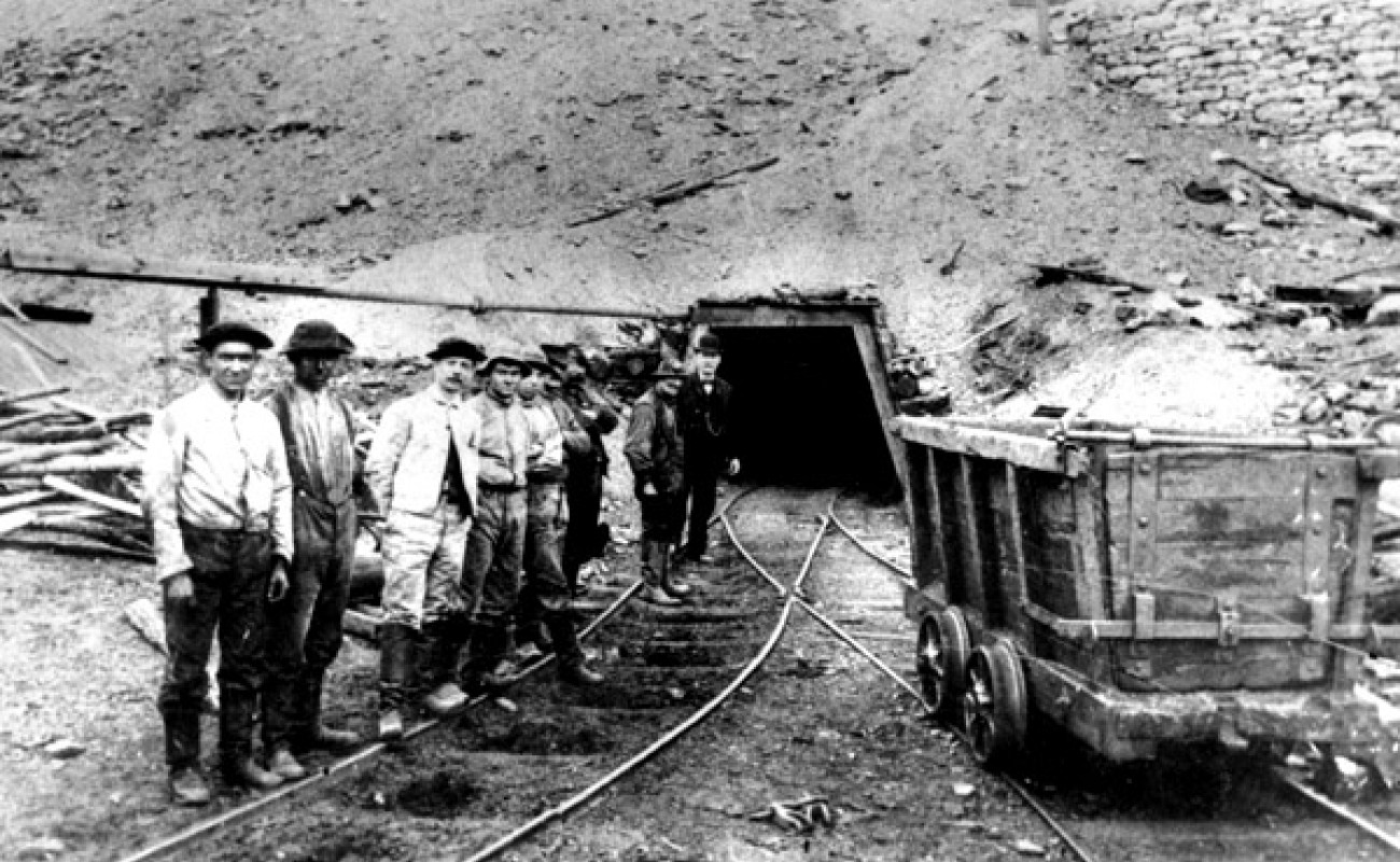 19th-century coal miners outside of mine