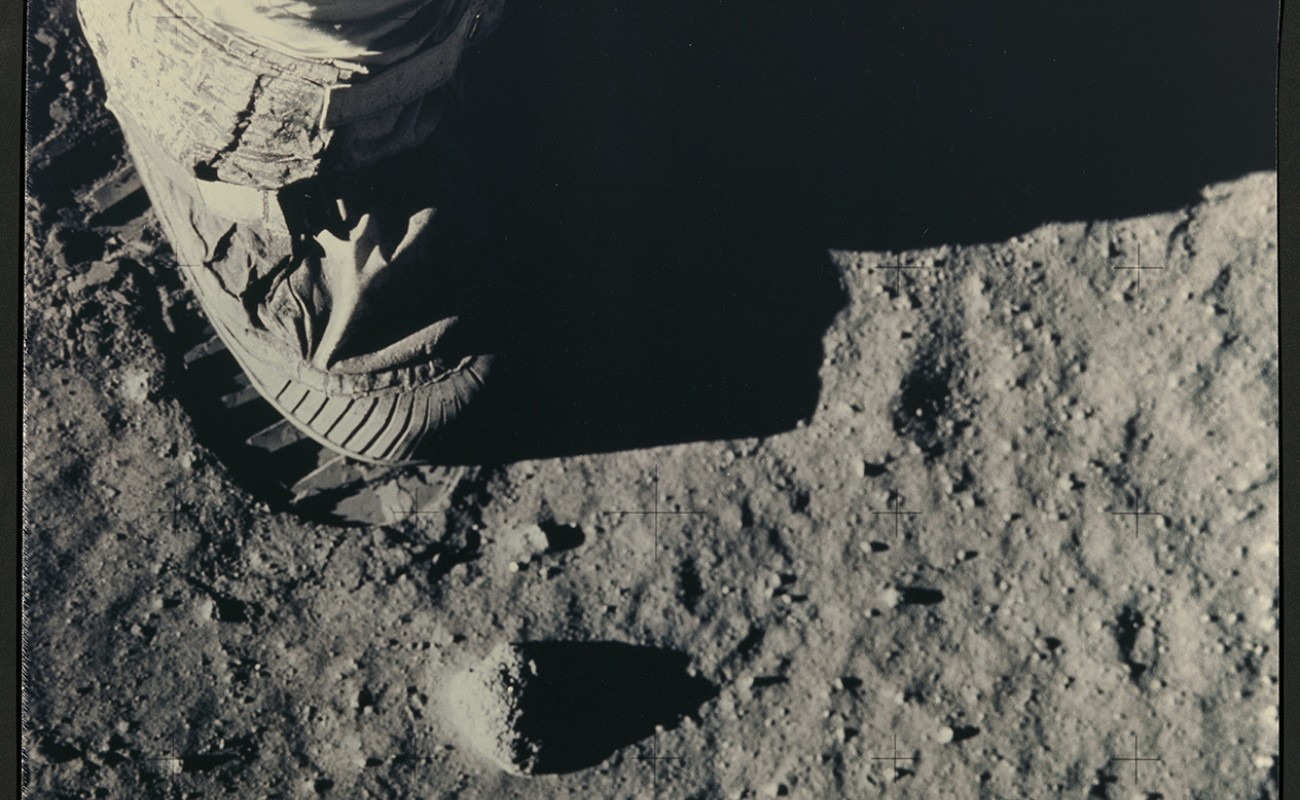 boot of spacesuit and footprint on moon