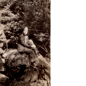 Mary R. Haas sitting on log