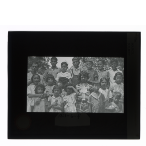 Black-and-white glass lantern slide of a group portrait of Creek children, Alabam.