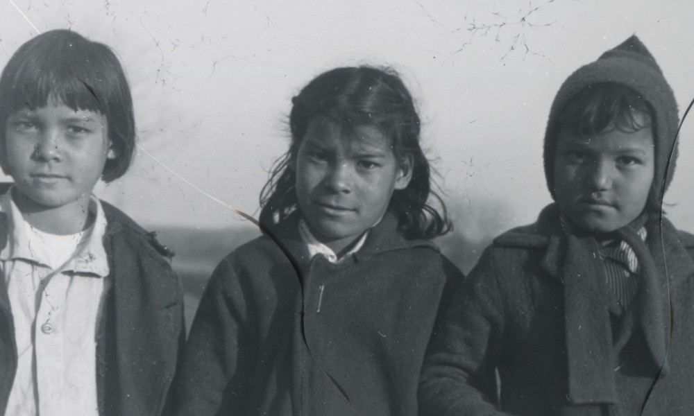 black and white image of three children