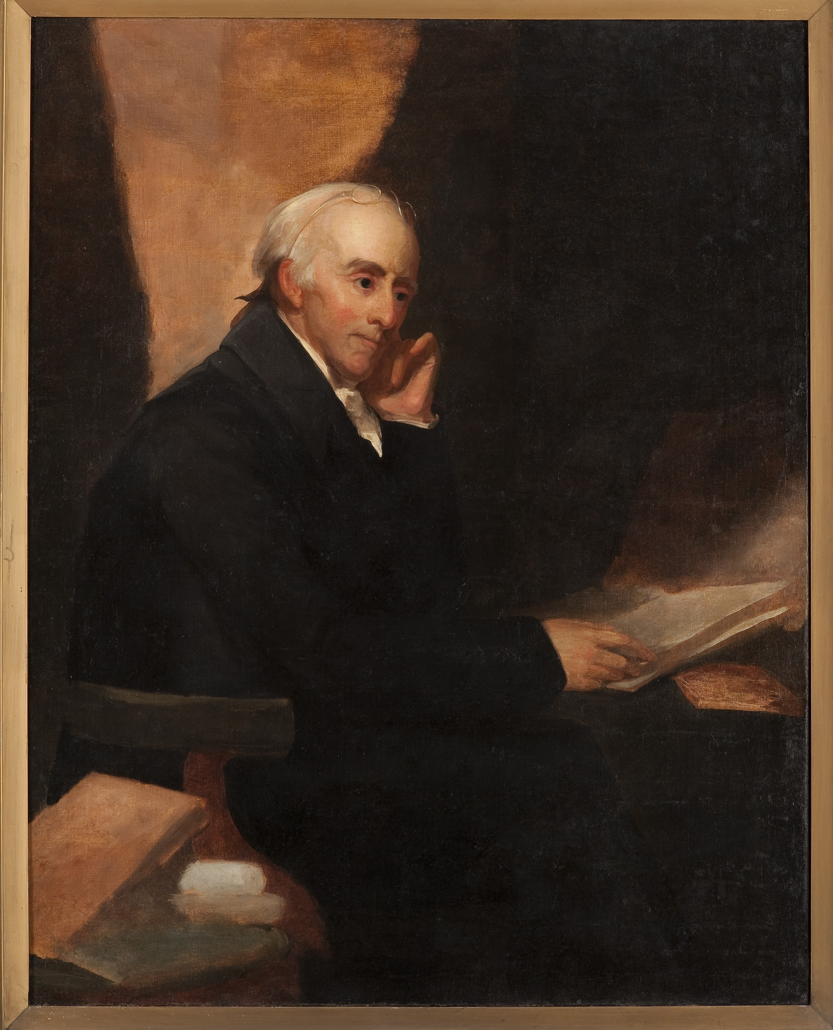 painting of man in black robes seated at desk