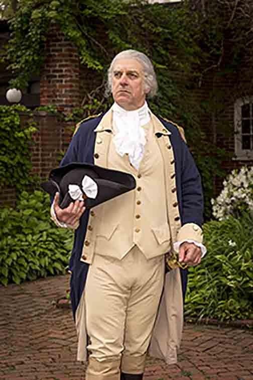 George Washington standing in a garden