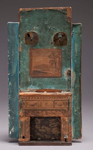 model of a fireplace painted green with decoration
