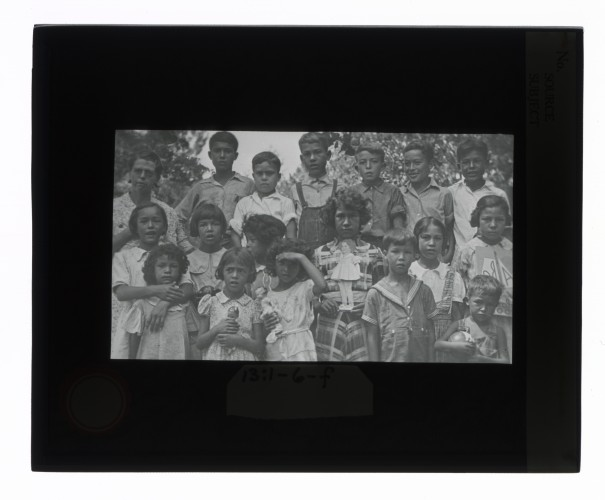 Black-and-white glass lantern slide of a group portrait of Creek children, Alabama.